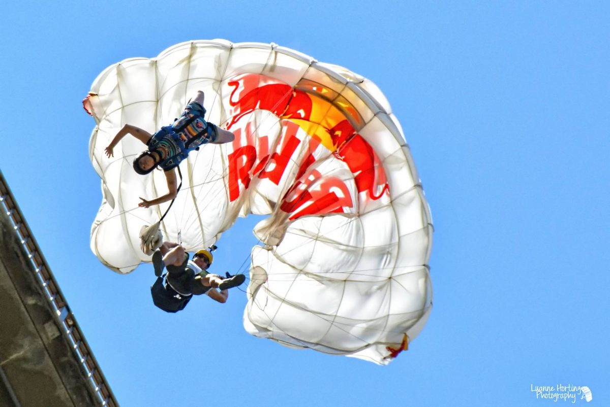 A photo of Miles Daisher just as his parachute is inflating from a BASE jump.