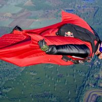Luke Aikins flying in his red wingsuit.