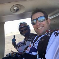 Luke and Andy Farrington in a helicopter preparing for a demonstration jump.