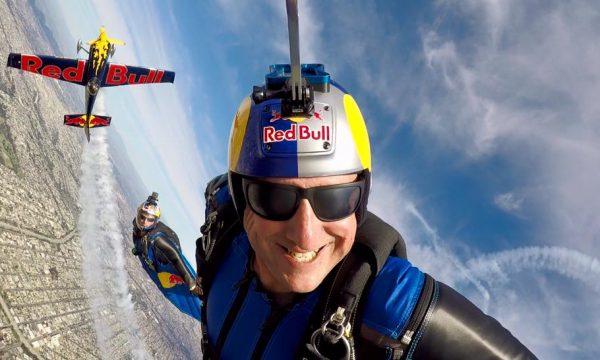 Luke Aikins grins while flying his wingsuit.