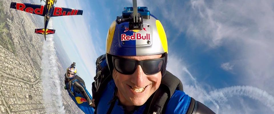 Luke Aikins grins while flying his wingsuit.