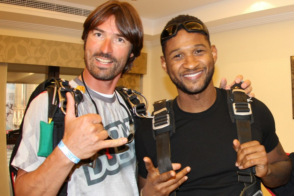 Frank poses with musician, Usher before making a skydive.