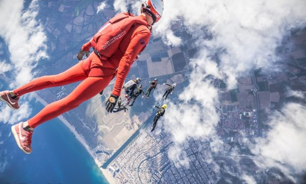 Will Penny free flying in a red jumpsuit.