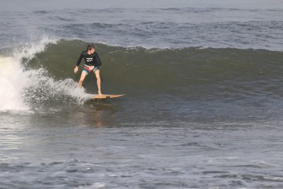 James surfing a wave.