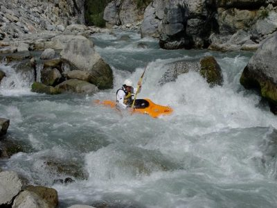 James kayaking through whitewater rapids.