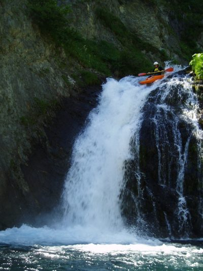 James kayaking down a waterfall.
