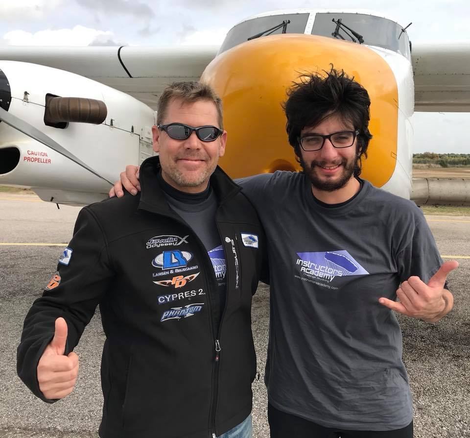 Marcus gives a thumbs up with one of his students in front of one of the planes at Skydive Spain.