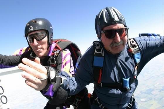 Adam Schmucker jumps with his Dad, Cliff.