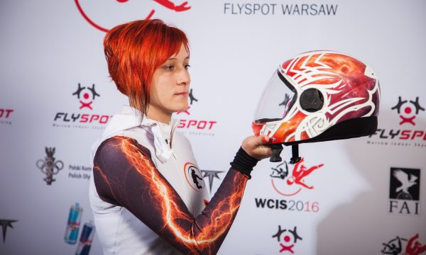 Olga Bakulina looks at her reflection from the glass shield of her helmet.