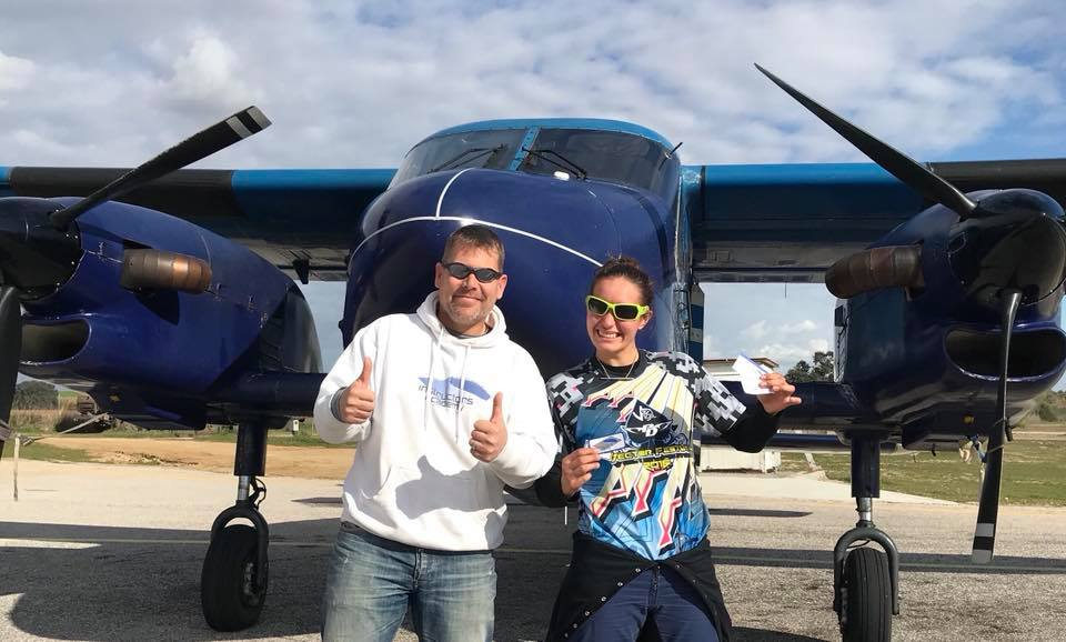 Marcus poses with one of his students in front of a Dornier aircraft at Skydive Spain.