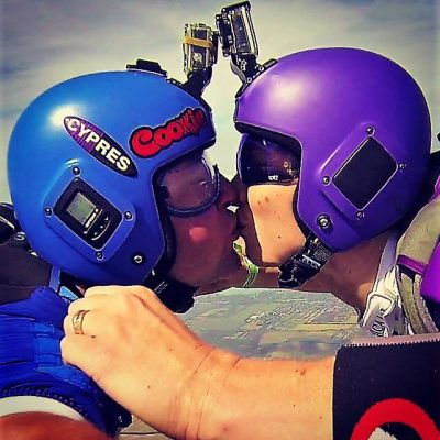 Mike and AJ kissing while in free fall.