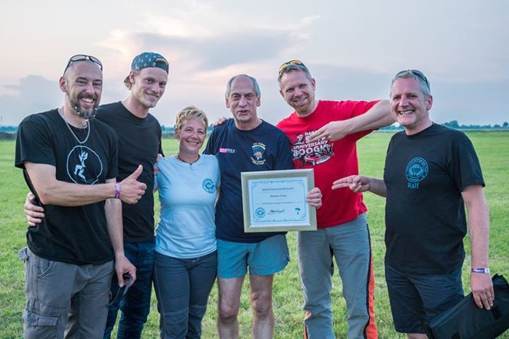 Jacky & Friends with Helmut Cloth at the CYPRES 25 years anniversary Boogie, making him a honorary member of the FSC Bielefeld skydiving club; Photo by Norman Kent.