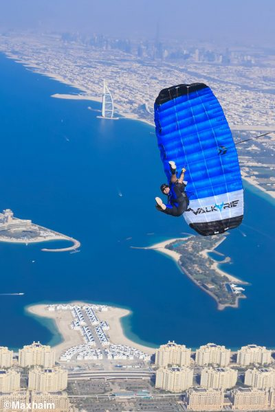 Pablo swings under his canopy above the city of Dubai
