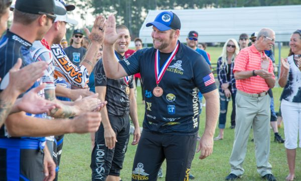 Greg Windmiller gives a high five to his students and fellow competitors following the US Nationals of Canopy Piloting