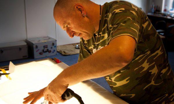 Raphael Schlegel repairing a parachute.