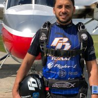 Mario poses in front of the Twin Otter at Skydive City in Zhills, Florida