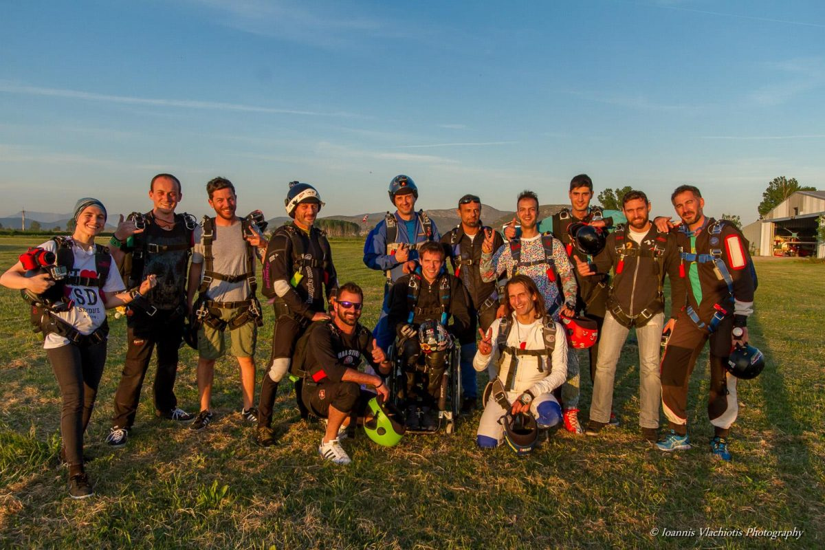 Posing with a group after a skydive