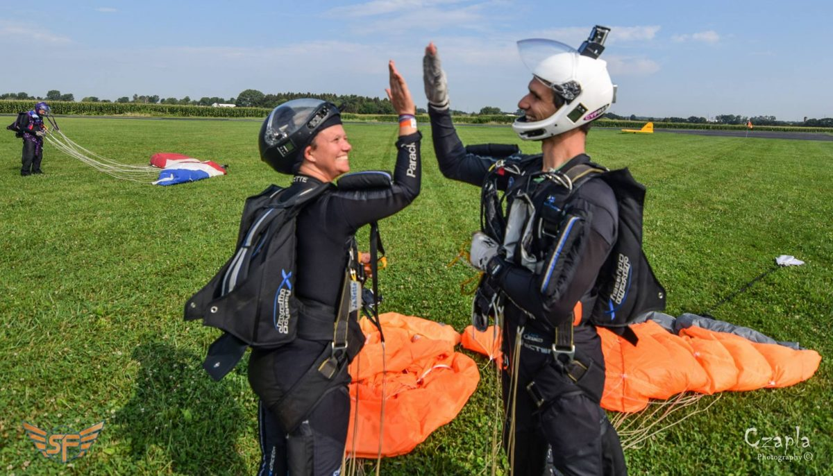 Steve and JaNette give each other a high five in the landing area