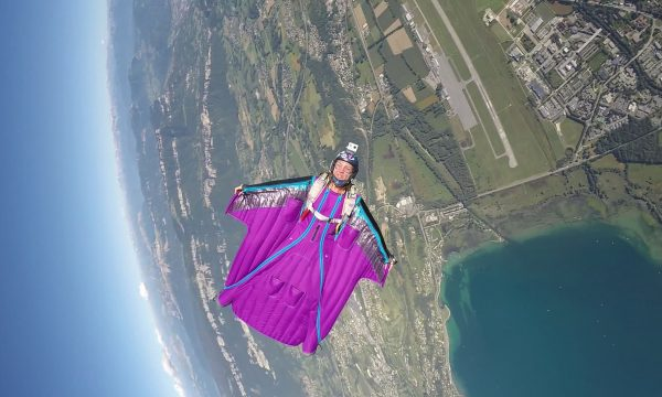 Marine flying her purple Squirrel wingsuit across the sky