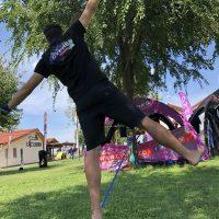 Joel Strickland balancing on a slackline