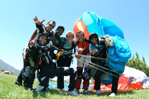 Eugenio smiles with his friends at Skydive Andes