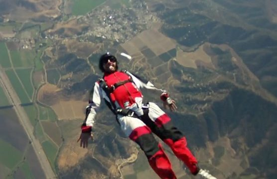 Eugenio tracking on his back during a skydive at Skydive Andes