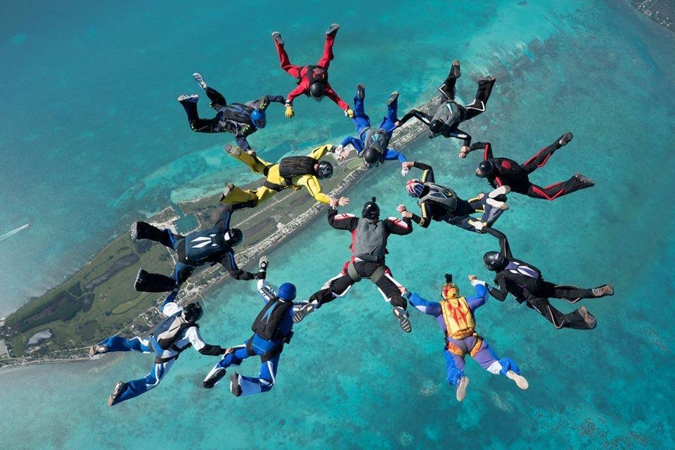 Regan Tetlow and a group of skydivers jump above the Maldives