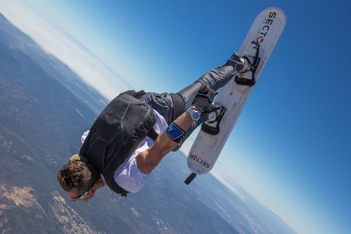 A photo of a skysurfer flying in a near head to earth body position