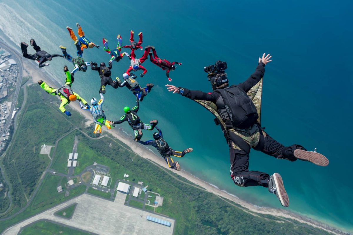 A photo of Craig O'Brien above a skydiving formation