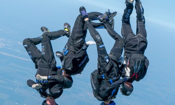 SDC Core flying in a head down orientation thousands of feet in the air above Skydive Chicago