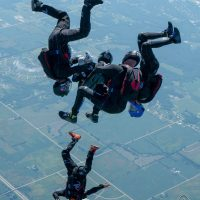 SDC Core turn points thousands of feet in the air abovec Skydive Chicago