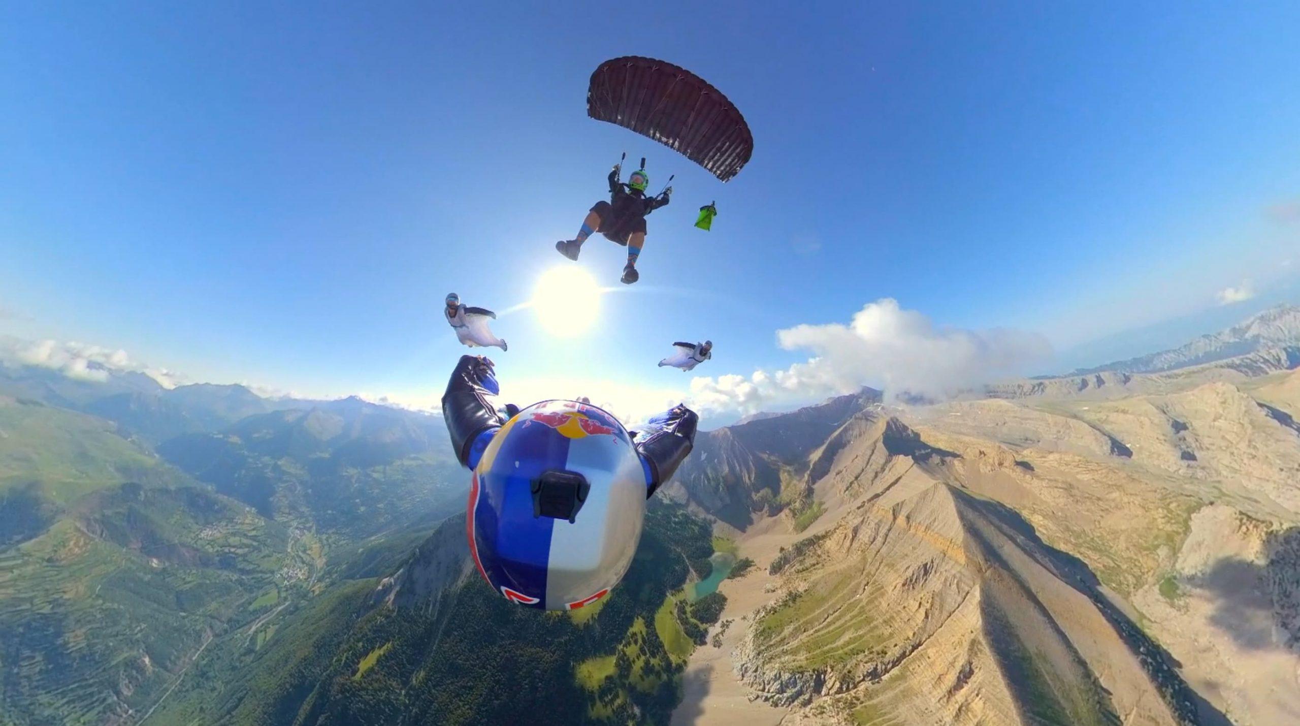 Pete Allum flies his parachute above wingsuiter Dani Roman