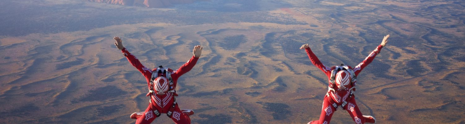 Team Air Wax photographed flying thousands of feet above Ayers Rock in Australia
