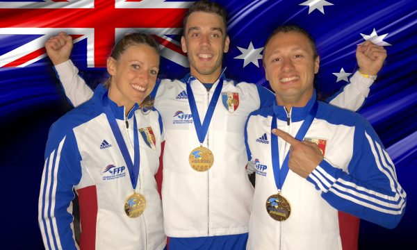 Team Airwax smiles while wearing their gold medals from the World Meet