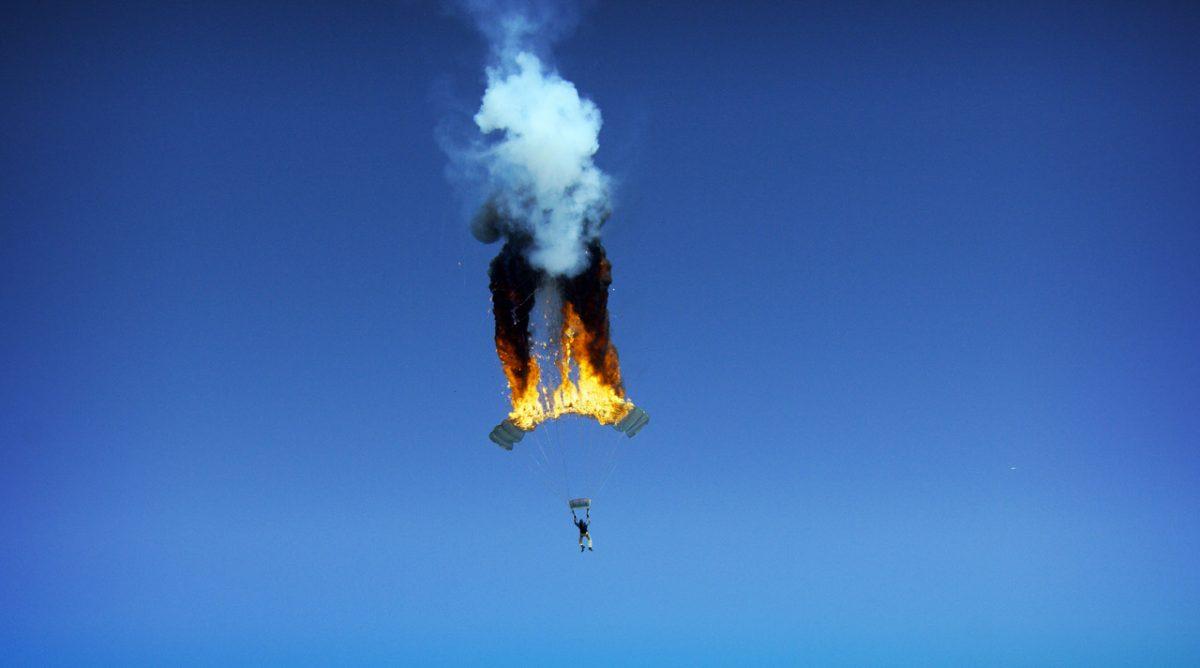 Joe Jennings photographs a stunt of a parachute on fire.