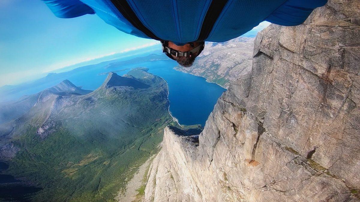 Jason Moledzki flies through the mountains while flying a wingsuit