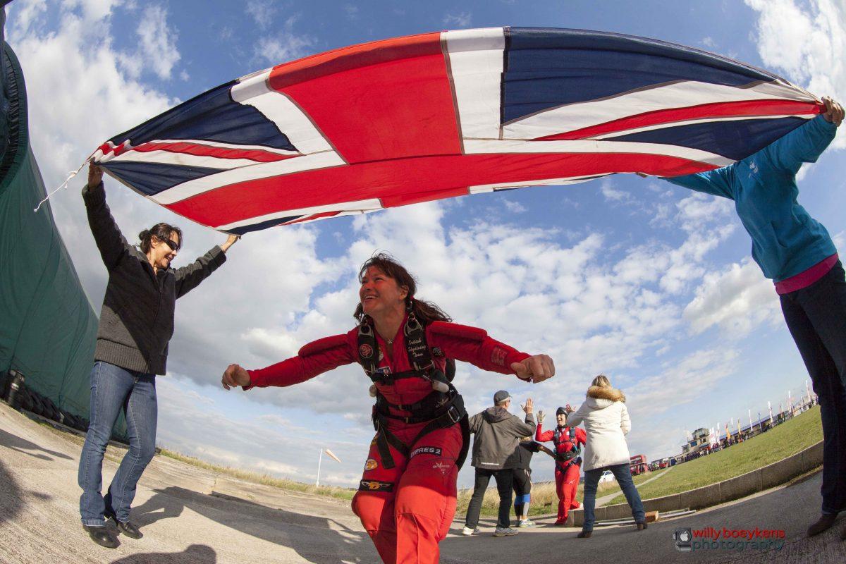 Lesley Gale walks under the Union Jack