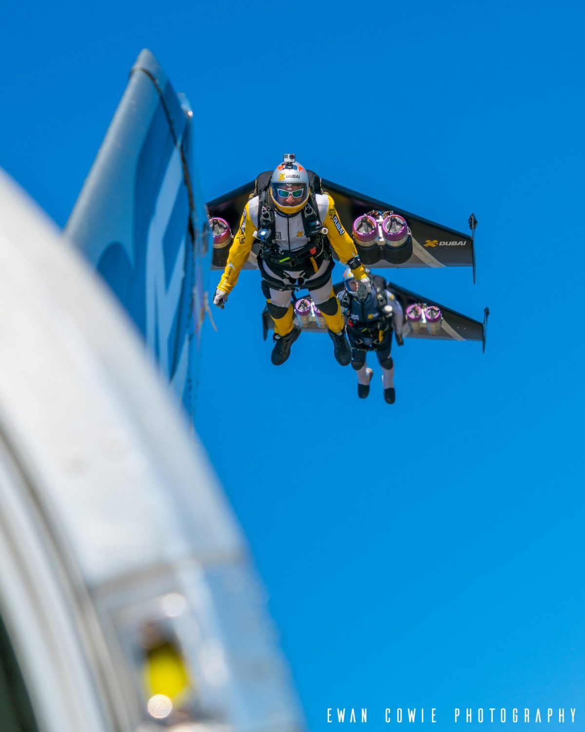 Fred and Vince flying in Jetman Wings alongside a Twin Otter